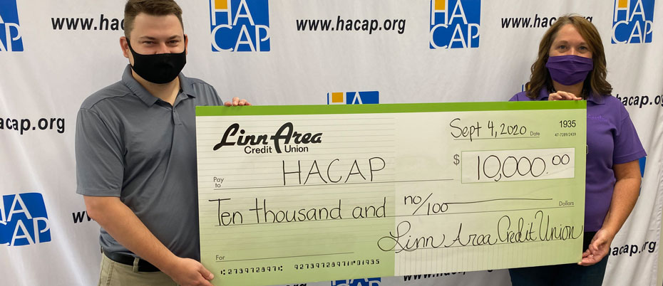 Linn Area and HACAP representatives holding oversized check for $10,000